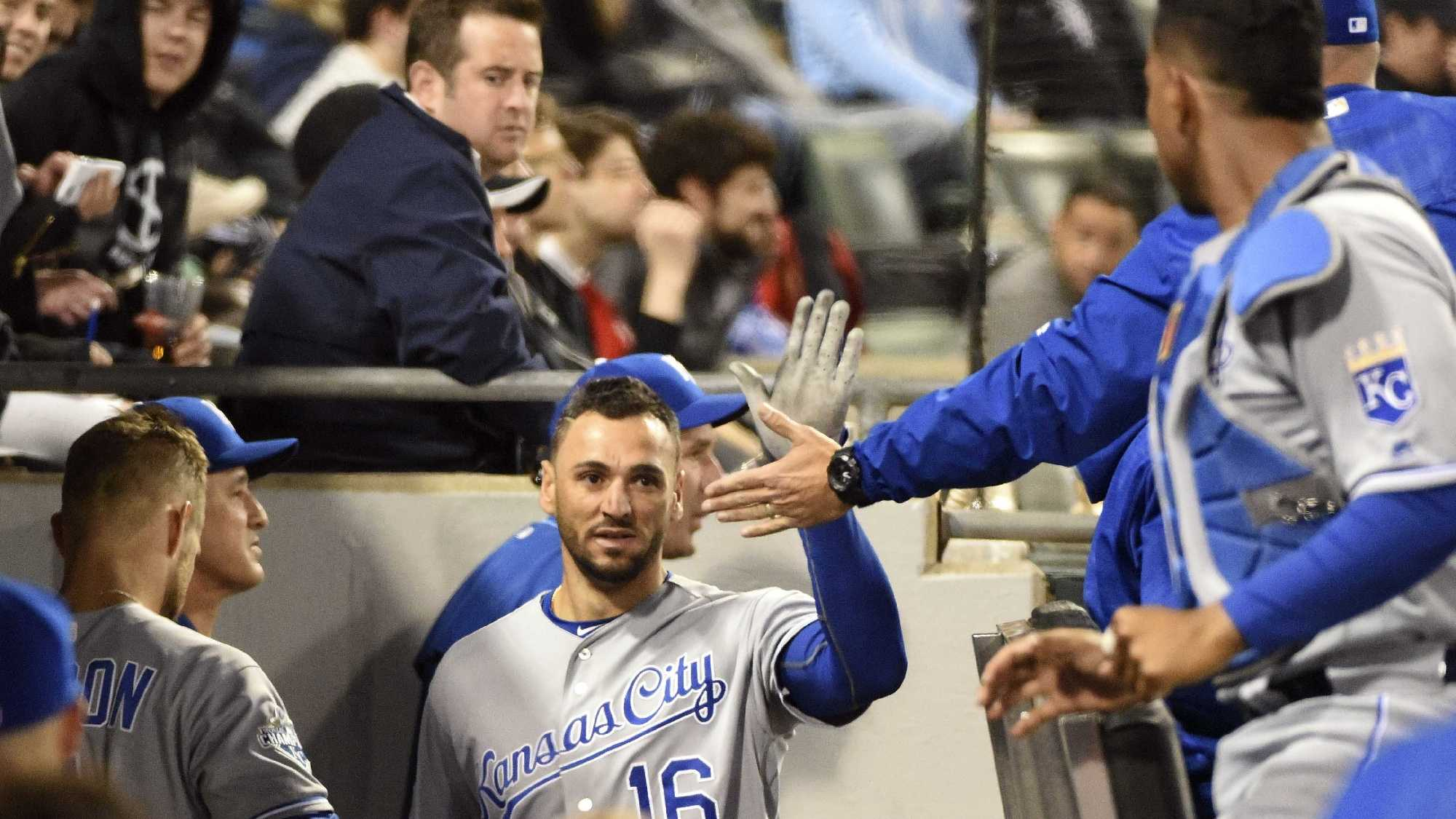Kansas City Royals' Paulo Orlando (16) is greeted by his teammates after scoring against the Chicago White Sox during the sixth inning of a baseball game, Friday, May 20, 2016, in Chicago. (AP Photo/David Banks)