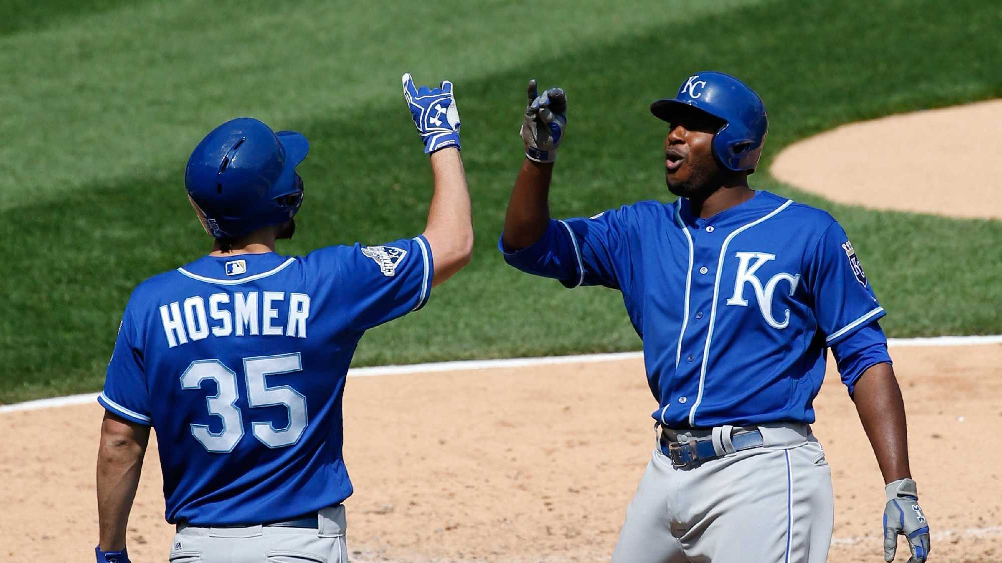 Kansas City Royals' Lorenzo Cain, right, celebrates with Eric Hosmer after hitting a solo home run during the sixth inning of a baseball game against the Chicago White Sox Saturday, May 21, 2016, in Chicago. (AP Photo/Nam Y. Huh)