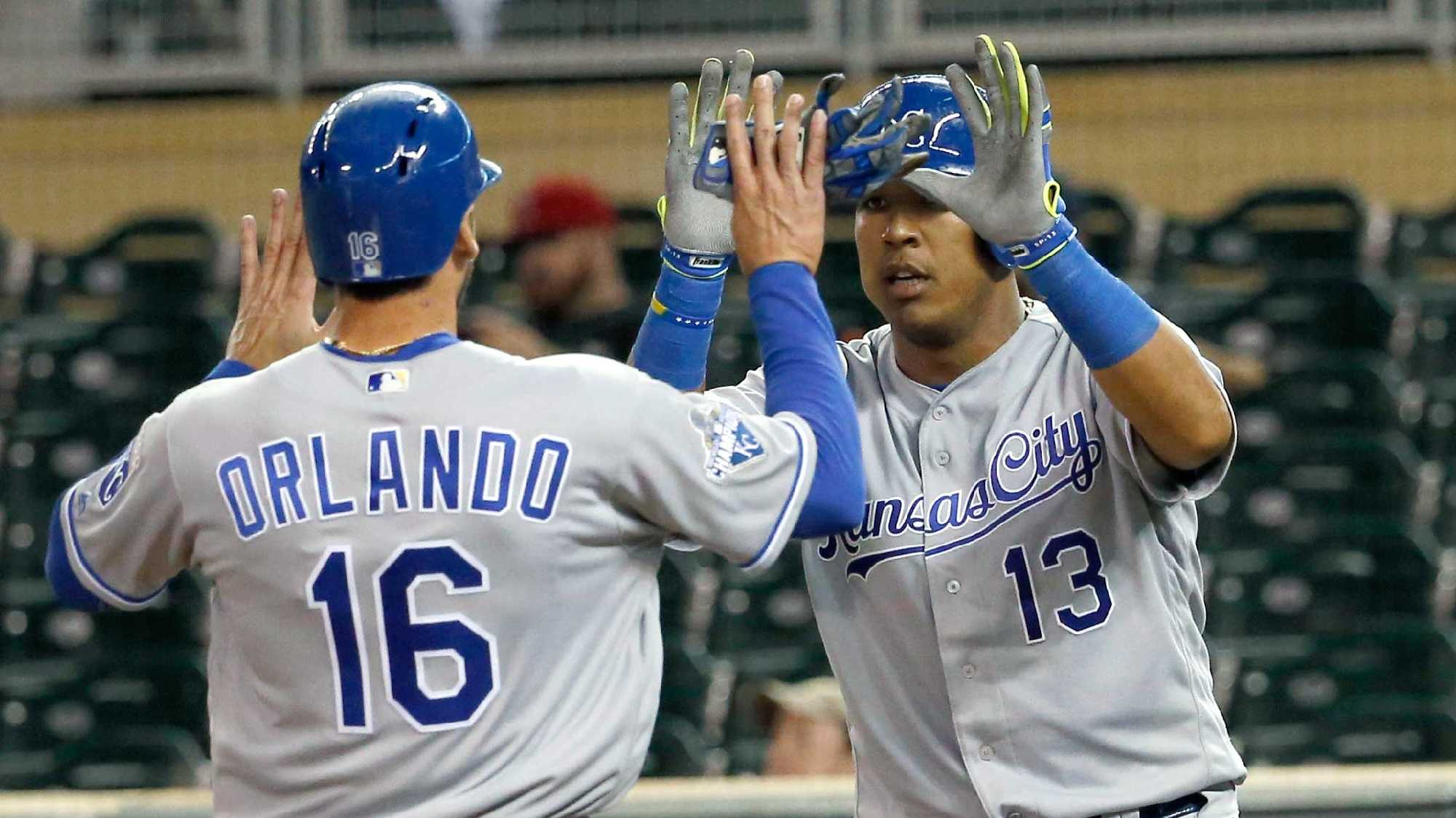 Kansas City Royals' Salvador Perez (13) and Paulo Orlando (16) celebrate after scoring on two-run double by teammate Omar Infante off Minnesota Twins closing pitcher Kevin Jepsen during the ninth inning of a baseball game in Minneapolis, Monday, May 23, 2016. The Royals won 10-4. (AP Photo/Ann Heisenfelt)