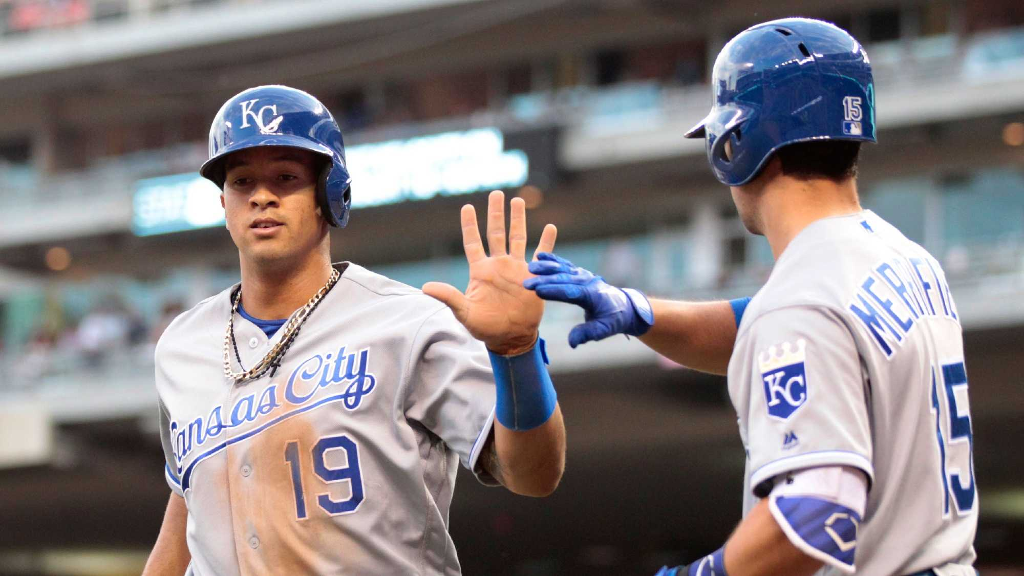 Kansas City Royals Cheslor Cuthbert is congratulated by teammate Whit Merrifield after scoring in the fourth inning during a baseball game against the Minnesota Twins on Tuesday, May, 24, 2016 in Minneapolis. (AP Photo/Andy Clayton-King)