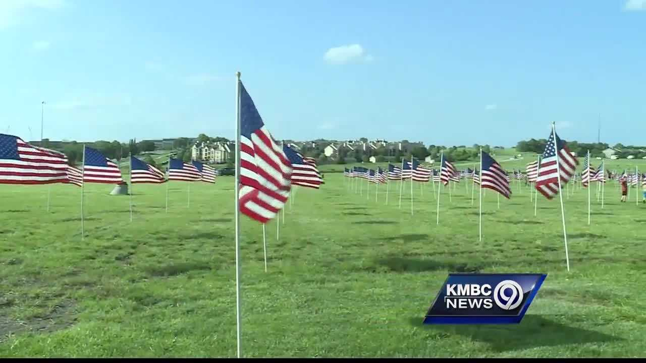 Kansas City-area Boy Scouts continued a Memorial Day weekend tradition Wednesday of creating a massive American flag display in Lenexa.