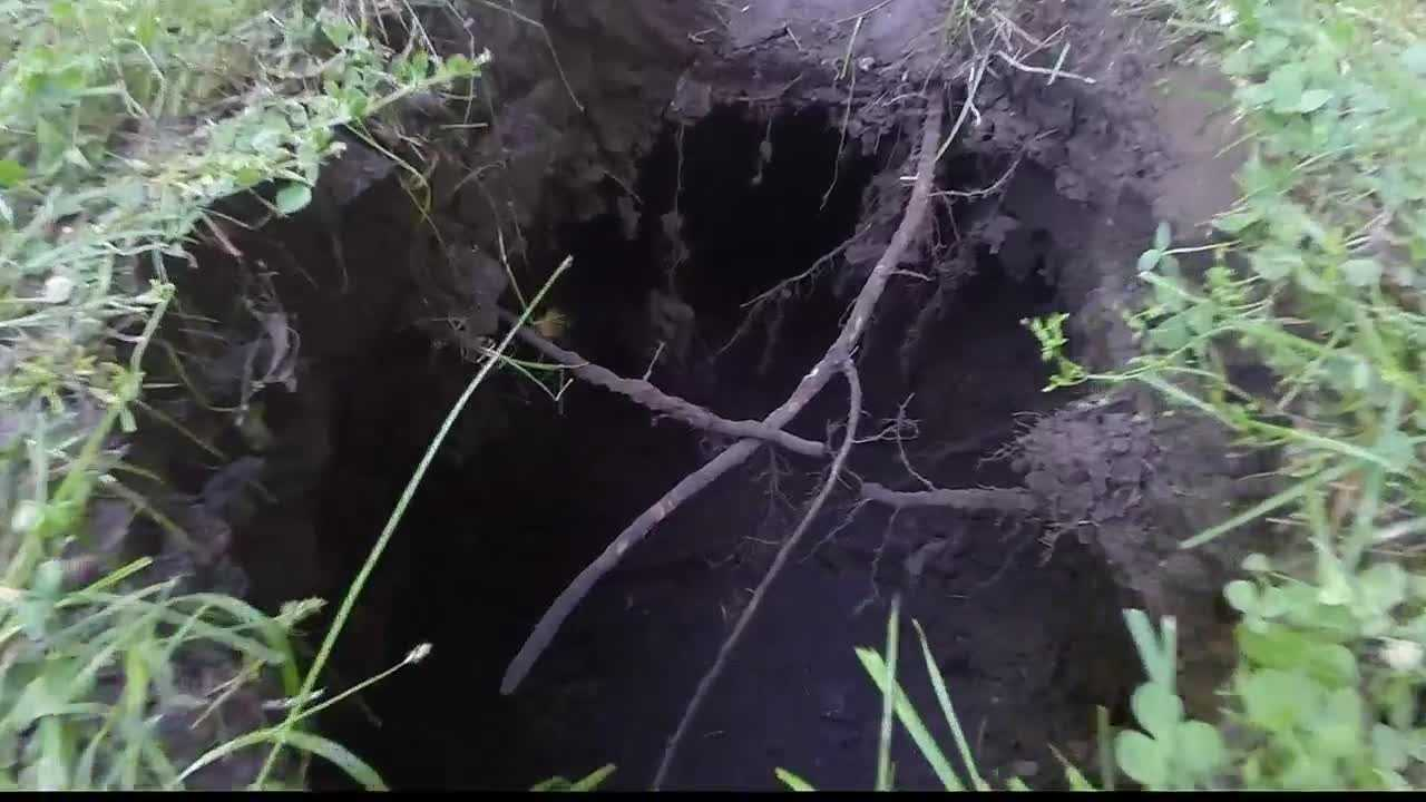 An Excelsior Springs man is looking for answers after ending up in a chest-deep sinkhole Sunday while working in his yard.