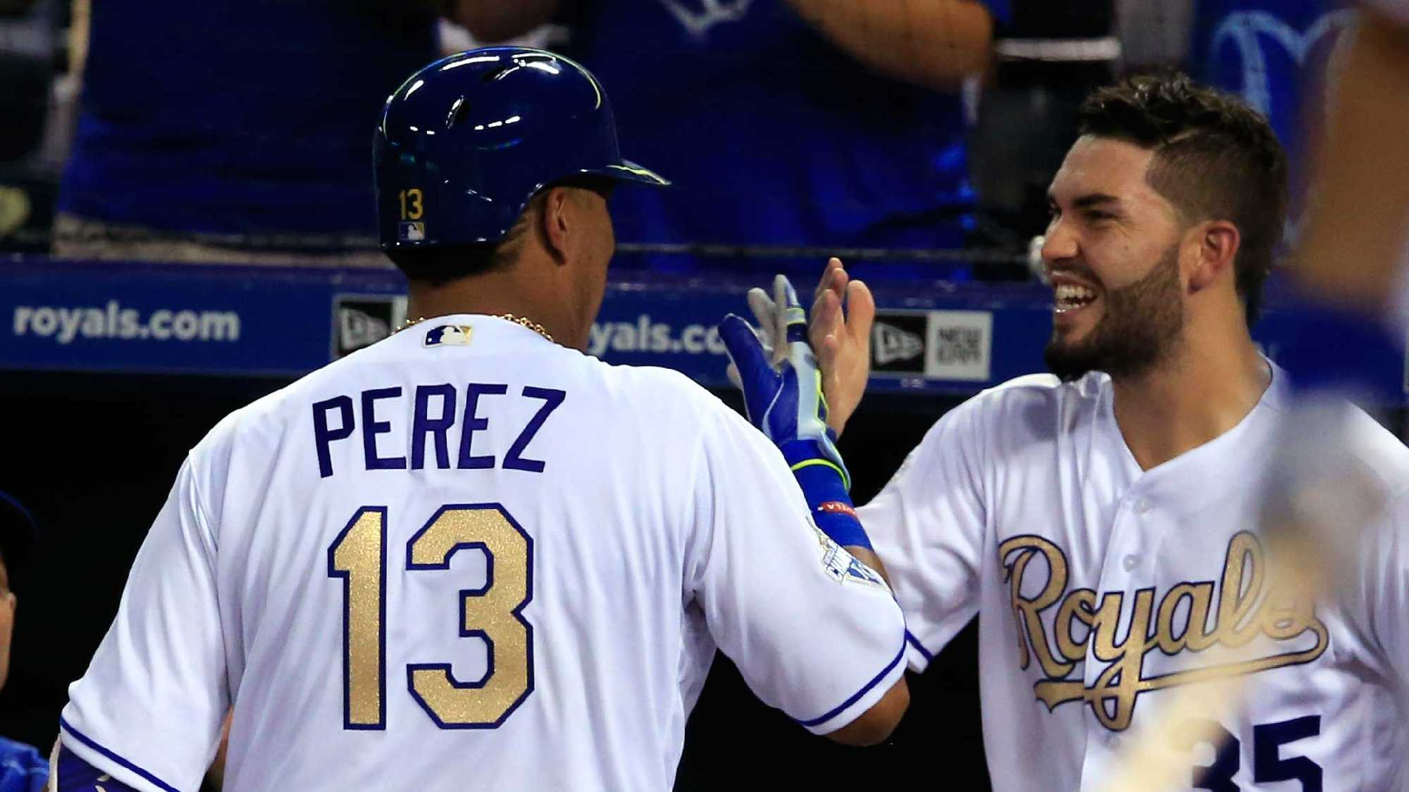 Kansas City Royals' Salvador Perez (13) is congratulated by Eric Hosmer (35) after his solo home run during the sixth inning of a baseball game against the Detroit Tigers at Kauffman Stadium in Kansas City, Mo., Friday, June 17, 2016. (AP Photo/Orlin Wagner)