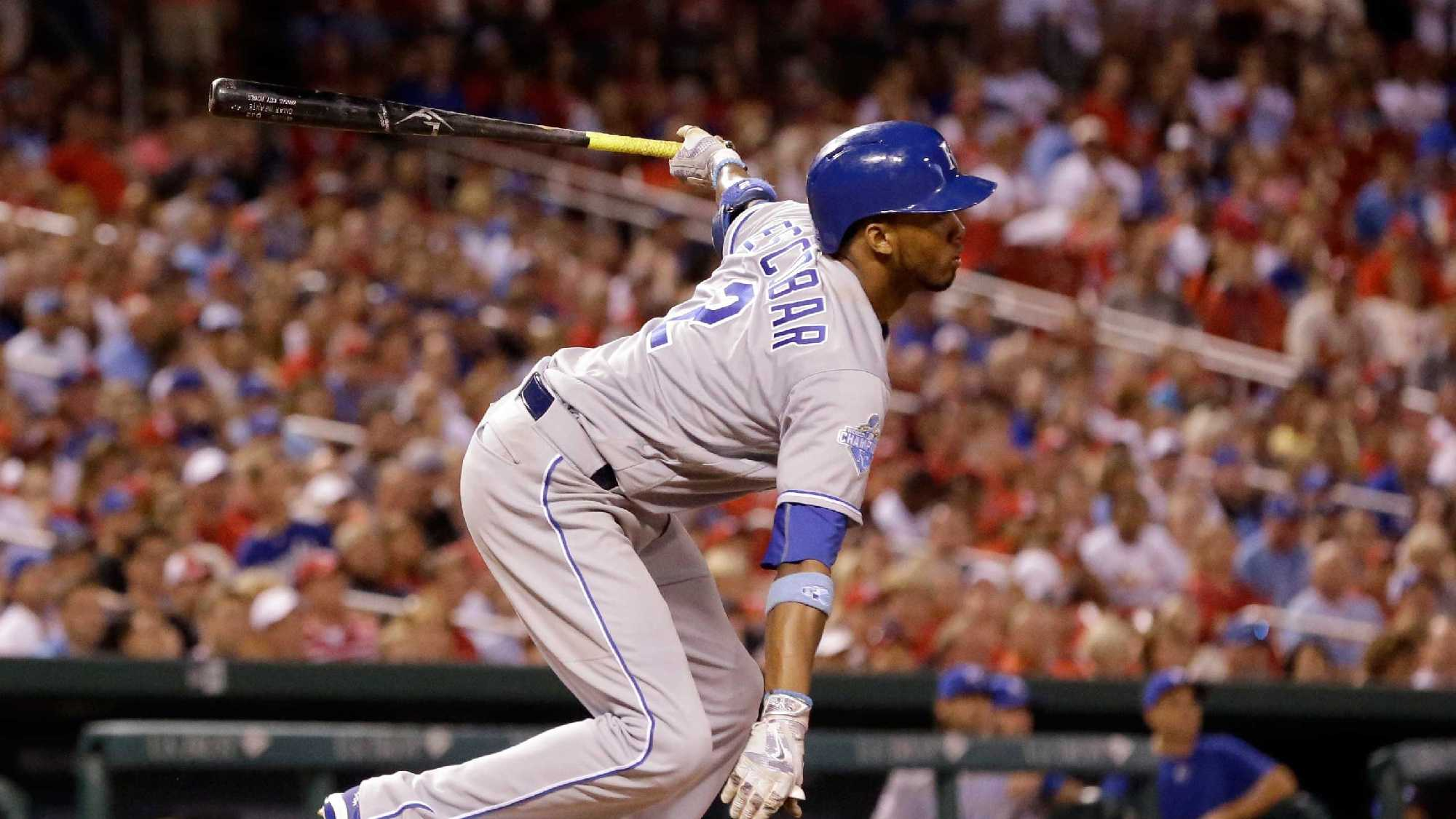 Kansas City Royals' Alcides Escobar follows through on a sacrifice fly to score Christian Colon during the eighth inning of a baseball game against the St. Louis Cardinals Wednesday, June 29, 2016, in St. Louis. (AP Photo/Jeff Roberson)