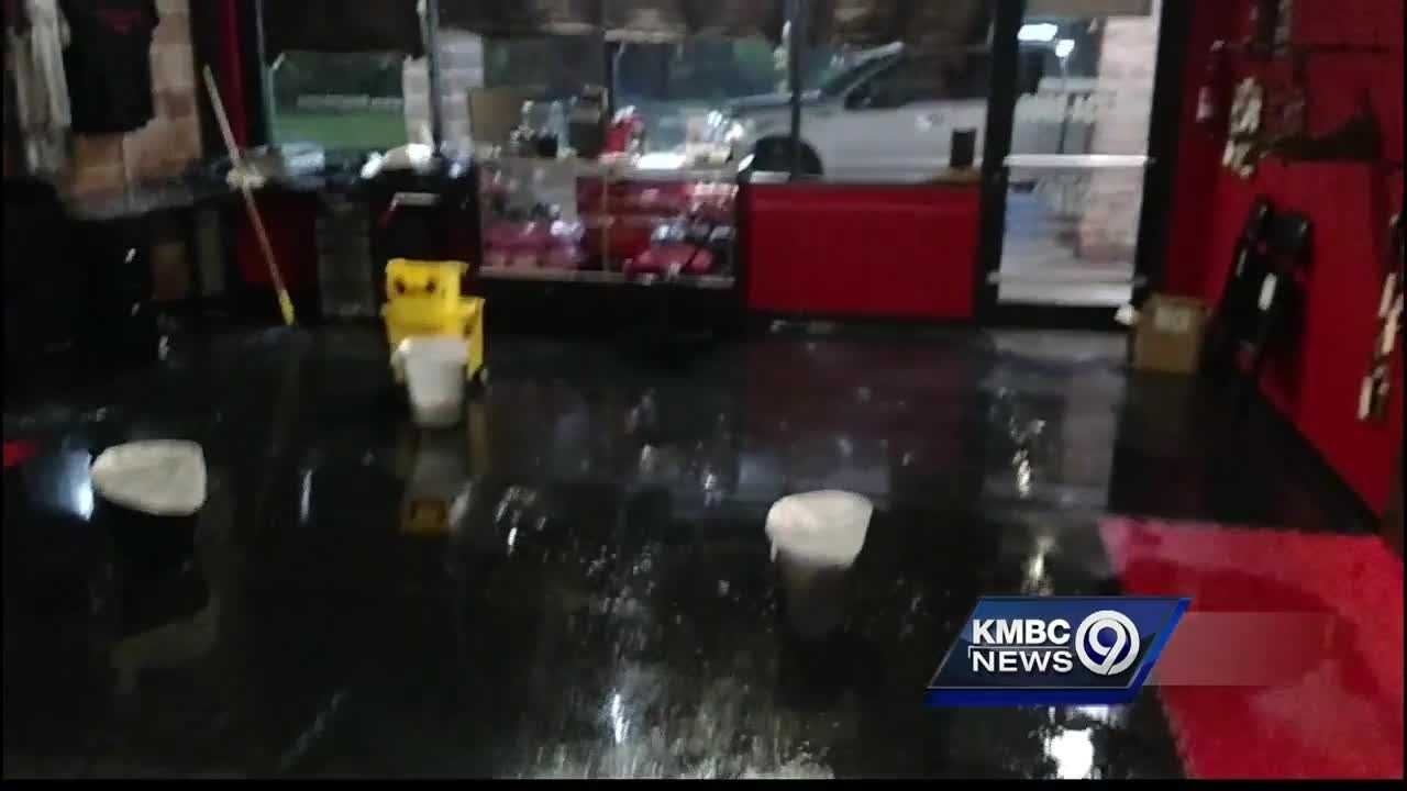 Cellphone cameras caught video of water pouring into the 9 Rounds Gym at Newmark Center after storms damaged the building's roof.