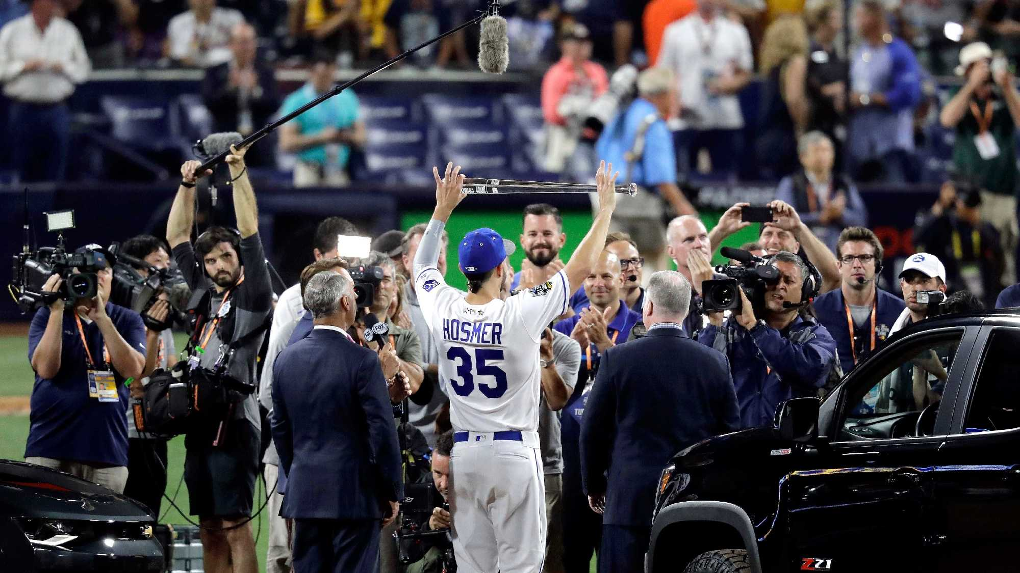American League's Eric Hosmer, of the Kansas City Royals, holds the MVP trophy after the MLB baseball All-Star Game, Tuesday, July 12, 2016, in San Diego. The American League won 4-2. (AP Photo/Jae C. Hong)