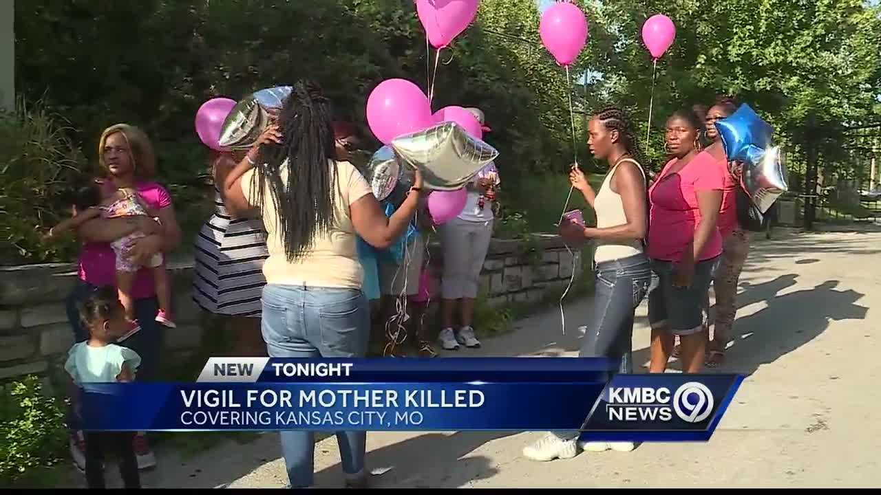 Friends and family members of Denise Gayle held a vigil Tuesday at Wabash and Independence avenues, not far from the area where she was killed last month.