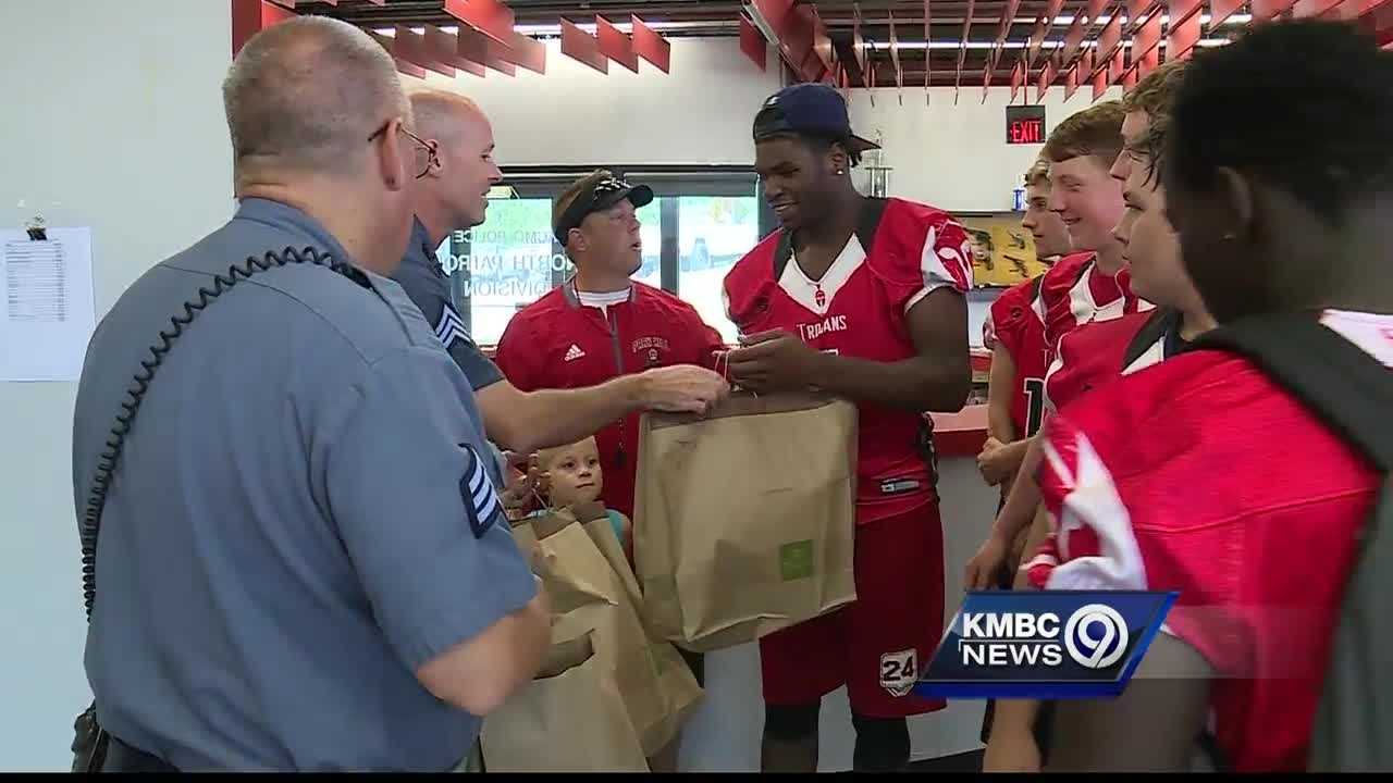 Members of the Park Hill High School football team deliver breakfast Wednesday morning to Kansas City police.