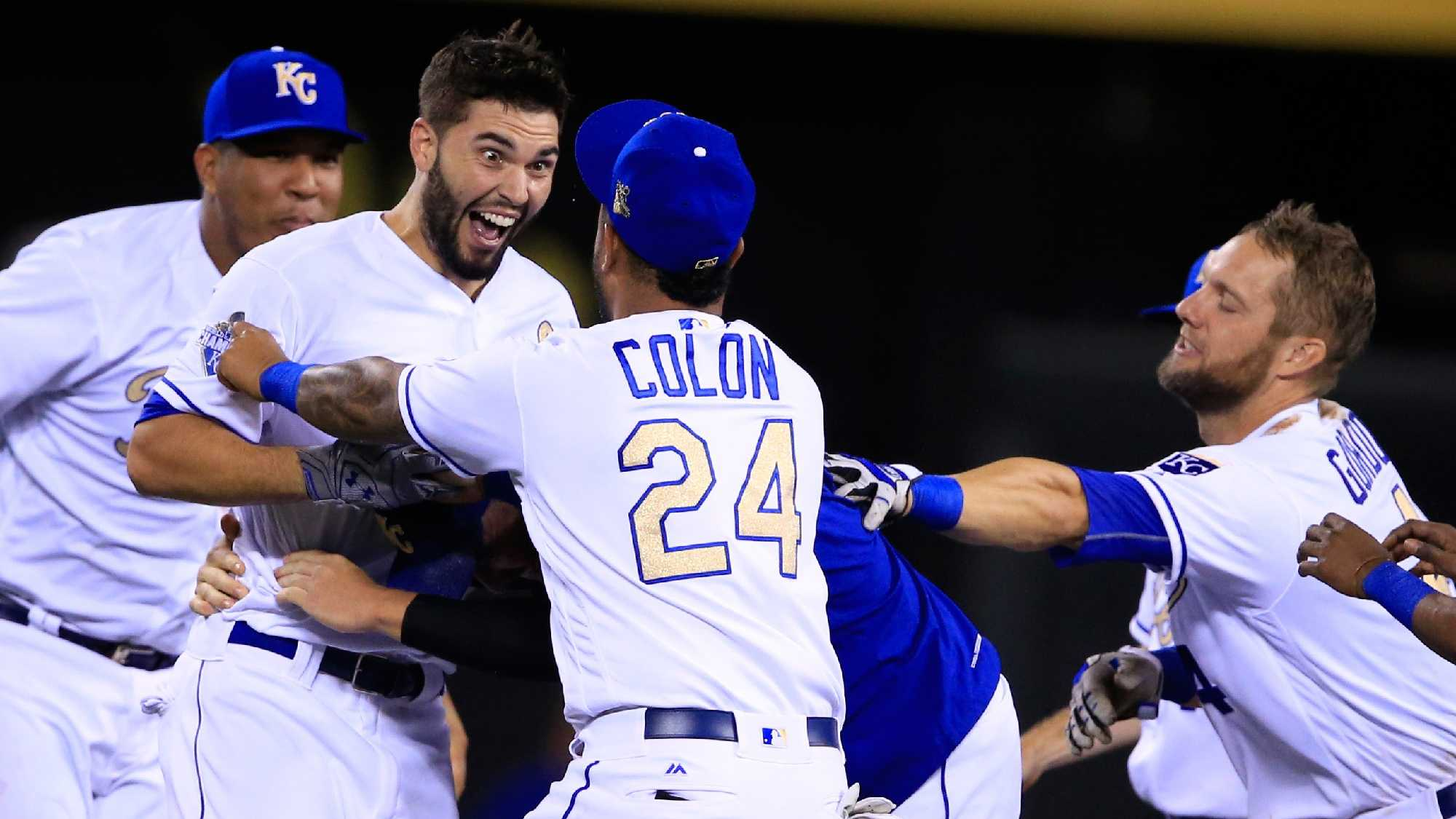 Kansas City Royals' Eric Hosmer (35) gets doused by teammate Salvador Perez (13) following a baseball game against the Minnesota Twins at Kauffman Stadium in Kansas City, Mo., Saturday, Aug. 20, 2016. Hosmer drove in the winning run. The Royals defeated the Twins 5-4 in 11 innings. (AP Photo/Orlin Wagner)
