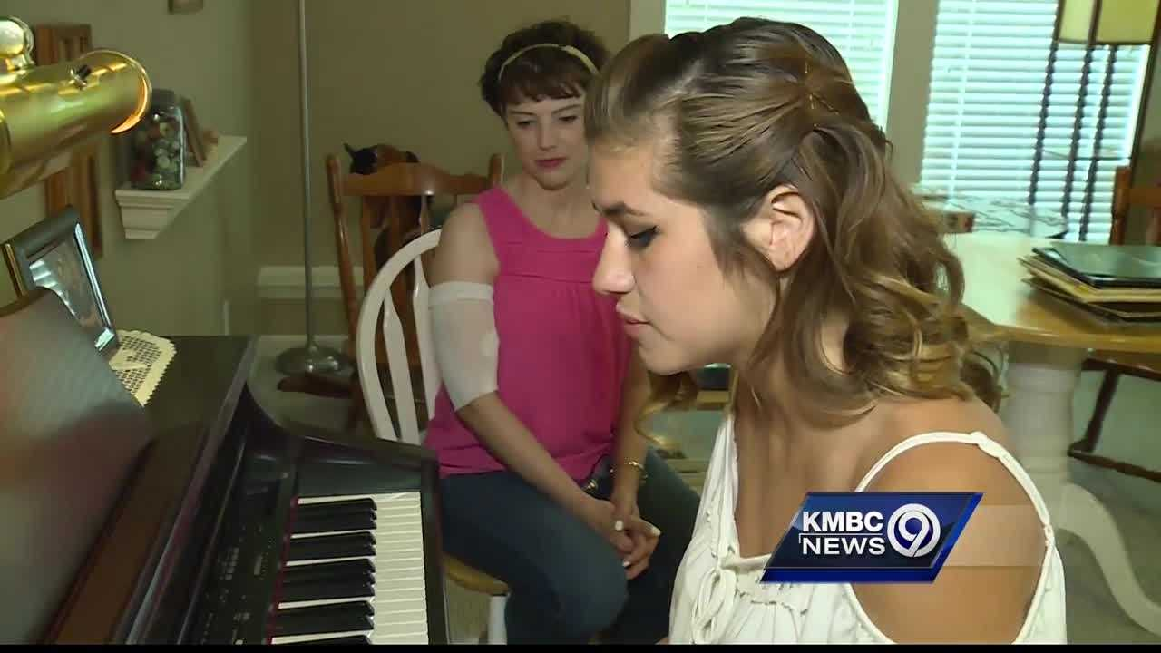 "An Olathe, Kan. teenager's ""Unbreakable"" song is giving cancer patients hope in the face of struggle."