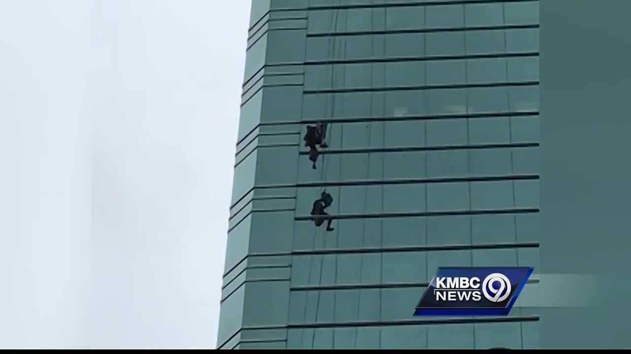 A Kansas City window washer is back on the ground after hanging from the side of a downtown building, tangled in his ropes.