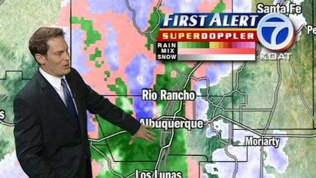Eric Green gives the morning weather on a wet April morning.