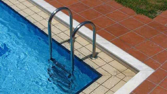 ladder into swimming pool