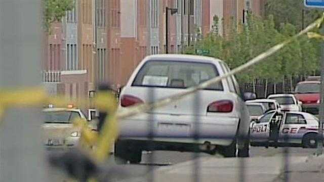 APD: Man wielding rifle shot by police