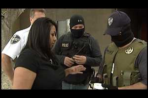 Officers show Action 7 News reporter Anna Velasquez the drugs they found.