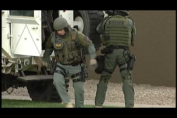 SWAT team arrives at the home in Los Lunas.