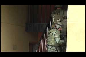 The SWAT team serves a search warrant.