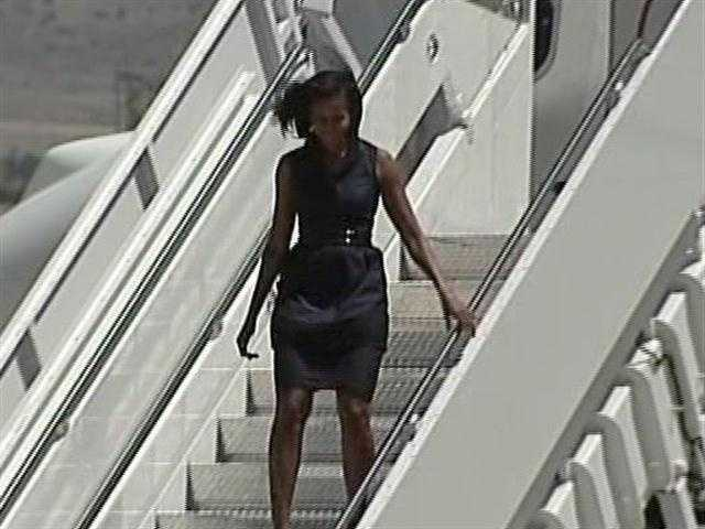The first lady landed about 2 p.m. and was greeted at Kirtland Air Force Base by about two dozen airmen and their families.