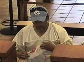 Authorities are looking for a heavily tattooed, barefoot man who robbed the New Mexico Educators Federal Credit Union at 6501 Indian School Road NE on Monday afternoon.