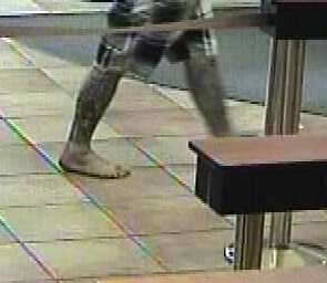 He entered the bank barefoot and had tattoos on both legs from his knees to his ankles. Witnesses say he entered the bank at about 2:30 p.m., put a handgun on a teller's counter and demanded money. He took an undisclosed amount of money and left in a vehicle.