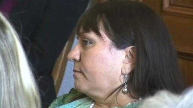 Cheryl Schultz is suing Pojoaque police for workers compensation. Her husband drowned while saving boy's life in 2002.