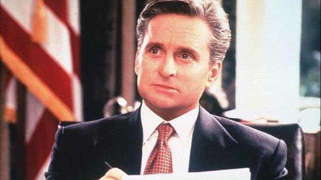 "1995: Michael Douglas as President Andrew Shepard in Rob Reiner's romantic dramedy ""The American President."""