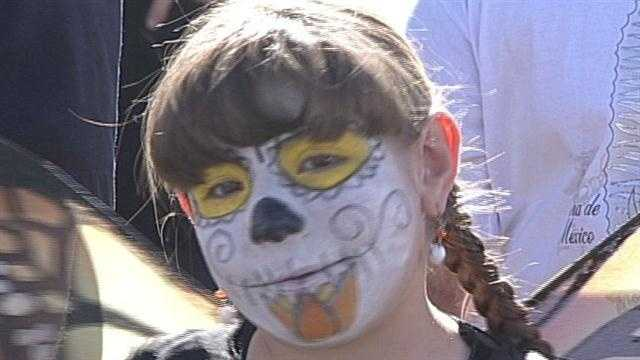 South Valley streets were lined with floats and people dressed in colorful costumes for the Day of the Dead celebration.