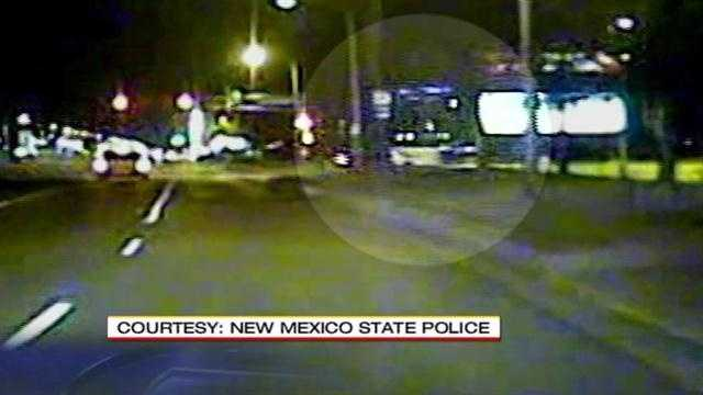 Caught on camera a woman suspected of driving drunk, plows into a streetlight, at a busy northeast Albuquerque intersection.