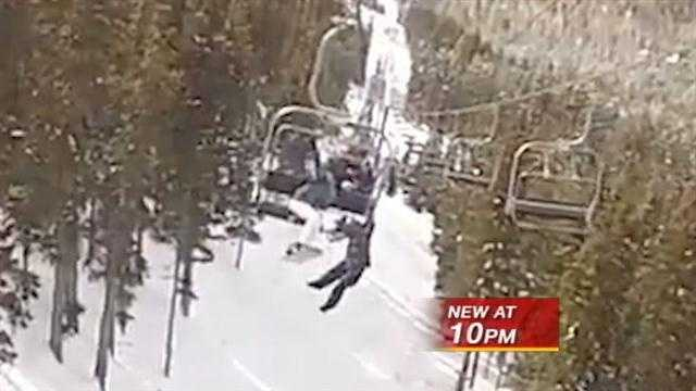 Snowboarder Falls From Ski Lift