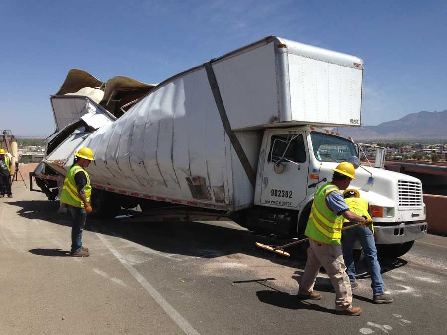 Interstate 25 southbound to Interstate 40 eastbound is shut down after officials say a semitruck flipped over on its side. See photos of the crash