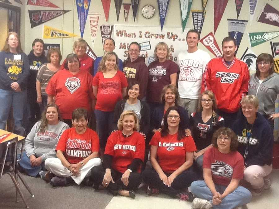 At E.G. Ross Elementary School the staff is focused on college readiness. We promote school spirit - for Elementary, Middle, High and College! In the School Counselor's office we display college banners that have been donated to her because she requested them from admissions offices at Colleges throughout the United States. Once a month we have College Shirt Day. Wearing the shirts and displaying the banners leads to the kids asking questions, so that the students are exposed to the idea of college and how many options there are for them. This photo shows some of our staff on our latest college shirt day in the School Counselor's room in front of some of the pennants. SCHOOL SPIRIT!!
