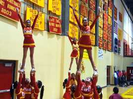 JV cheer stunting during a game.
