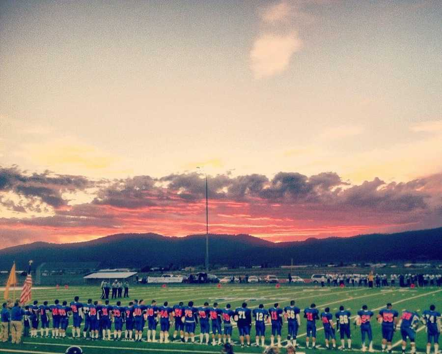This is a photo of the Questa Wildcats football team for their 2012-2013 October Breast Cancer Awareness game.