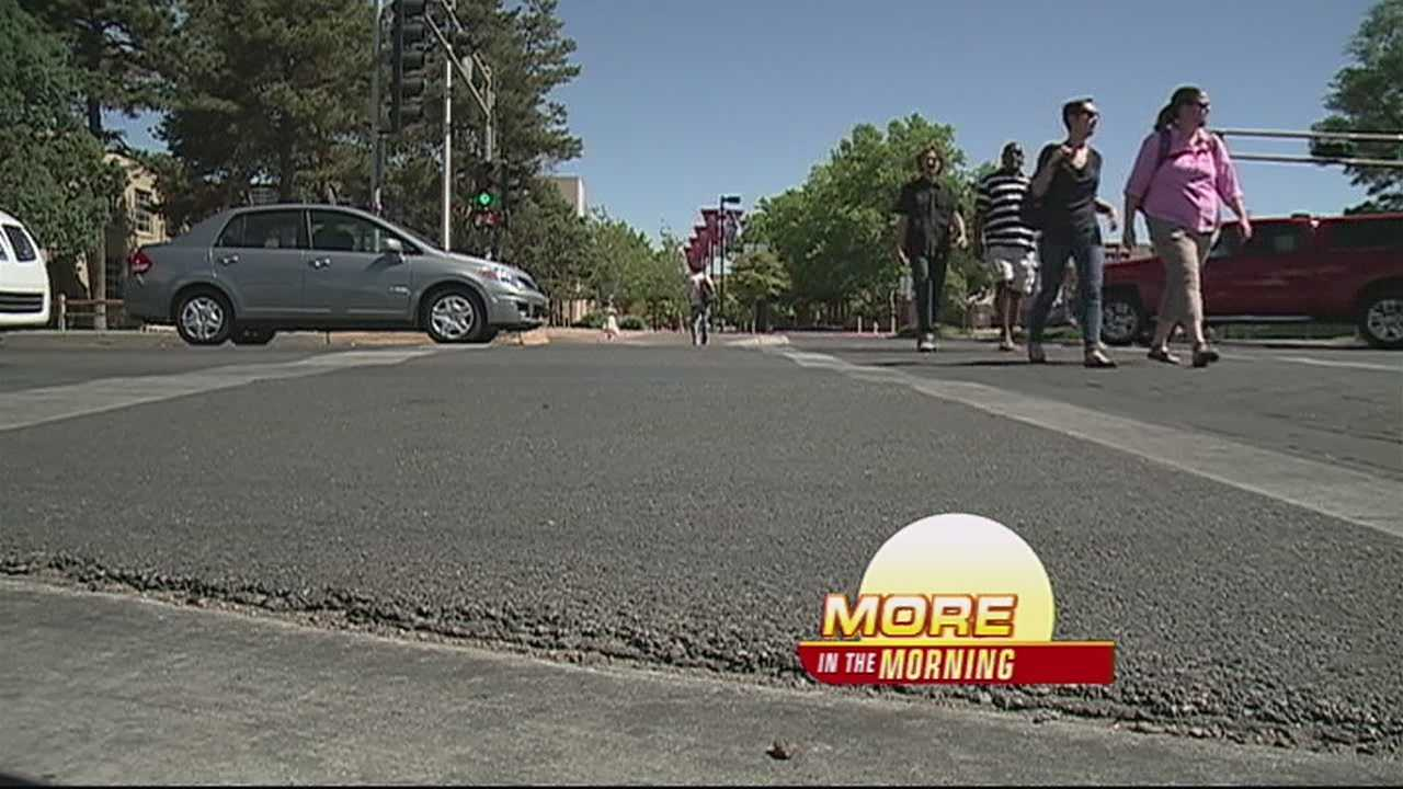 Students say crossing the street around UNM has become too risky and every day someone nearly gets hit.