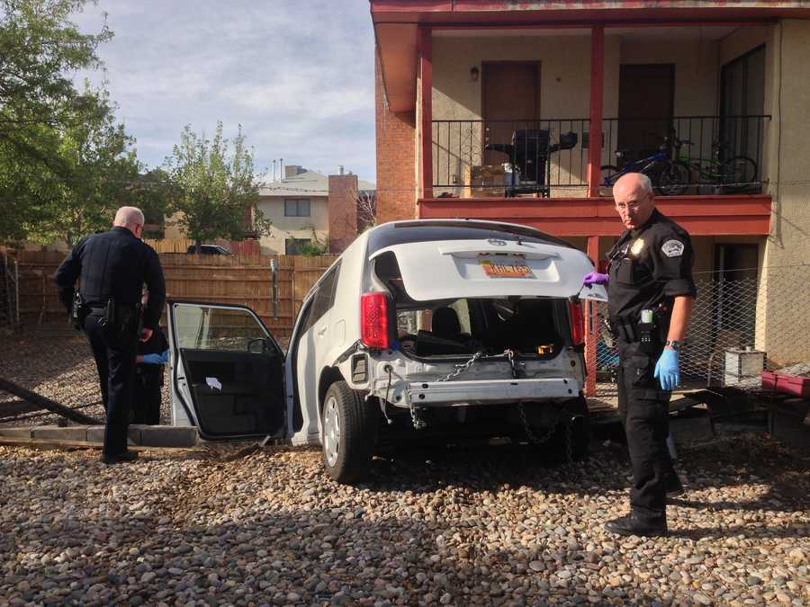 Albuquerque police said they arrested a man Tuesday morning who tried to pry an ATM open with his with his car.