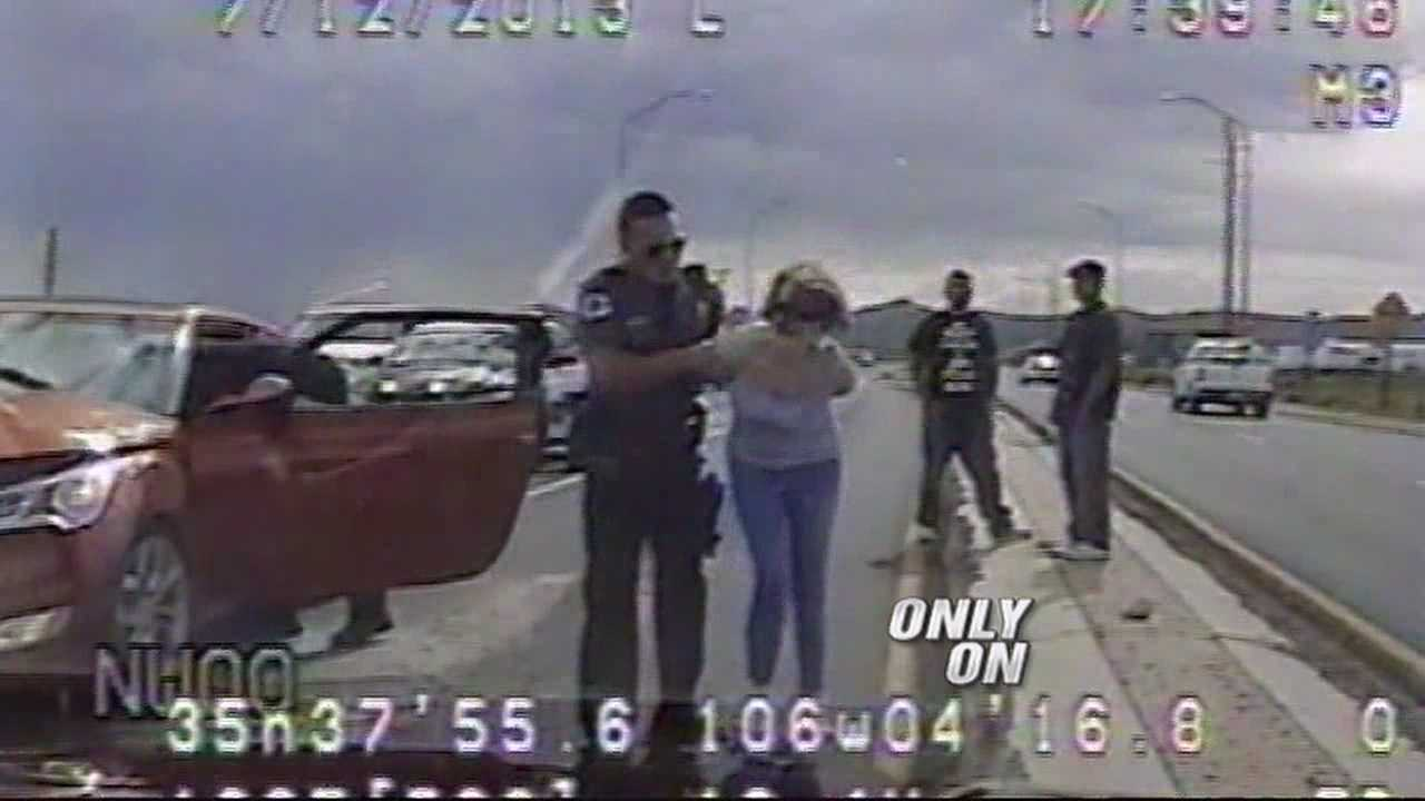 A SANTA FE WOMAN IS DRAGGED OUT OF HER CAR BY SHERIFF'S DEPUTIES, ALL WHILE HAVING A DIABETIC EPISODE.