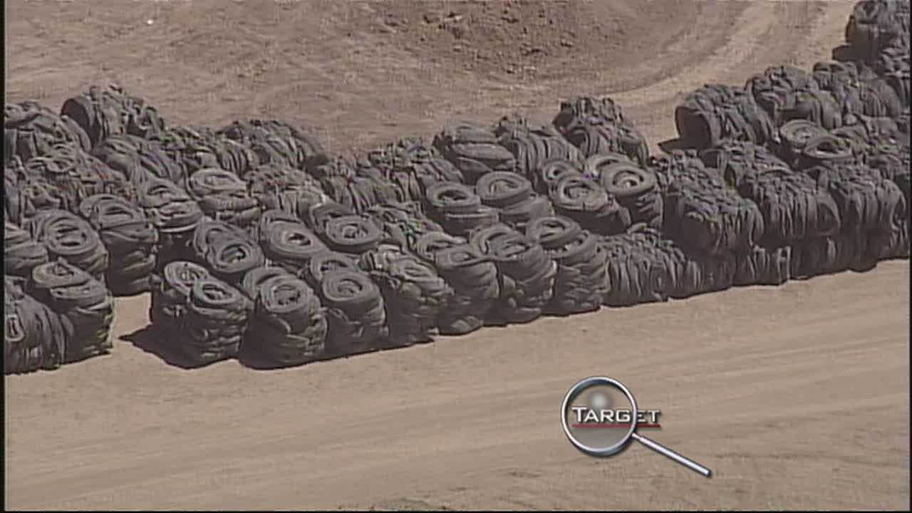 Dozens of tires thrown out illegally, now being cleaned up.