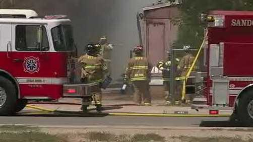 Dozens of fire crews worked a fire on the Sandia Pueblo to full containment on Sunday.