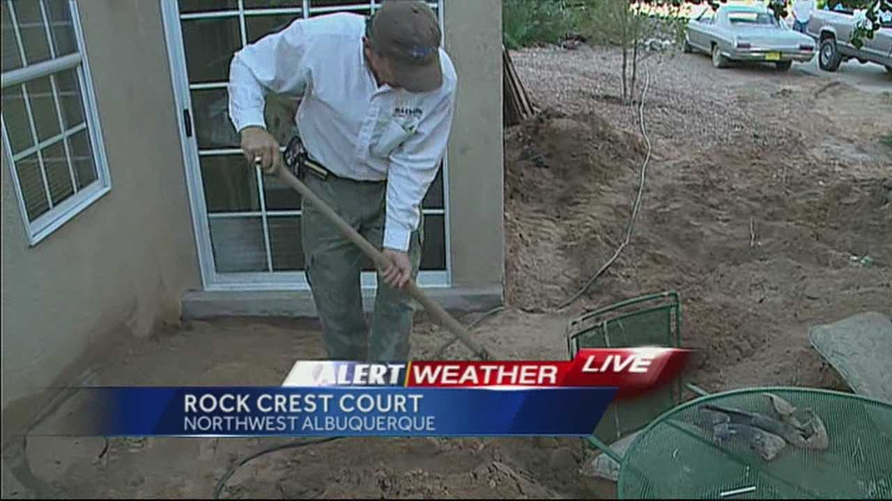 img-Families near Petroglyphs digging out after storm