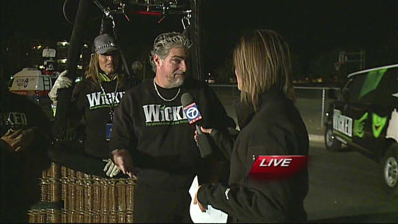 Reporter Angela Brauer talks with hot air balloon pilot Craig Kennedy about Friday morning's launch.