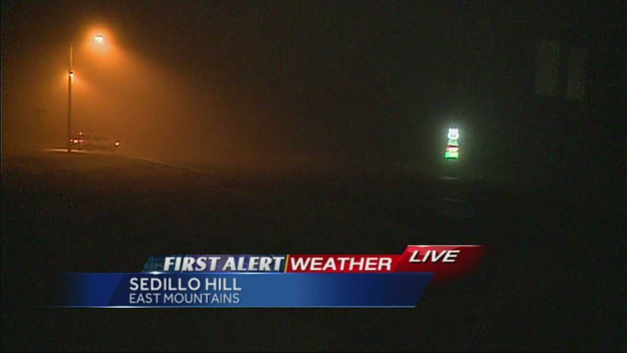 Cold temperatures, wind, fog and light snow hit the East Mountains early Wednesday morning.
