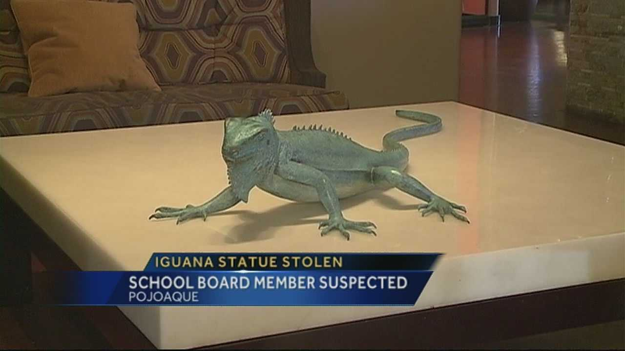 A school board member is accused of stealing a bronze statue of an iguana from a casino.