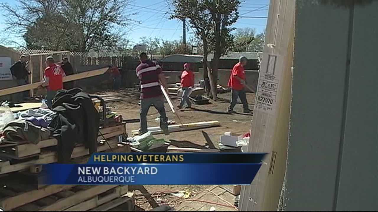 Volunteers with Home Depot spent Thursday remodeling parts of the home of two veterans.
