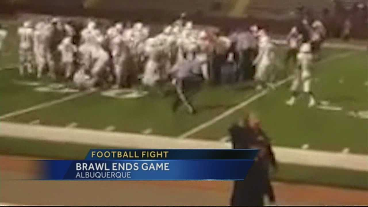 TWO HIGH SCHOOL FOOTBALL TEAMS EXCHANGE BLOWS.