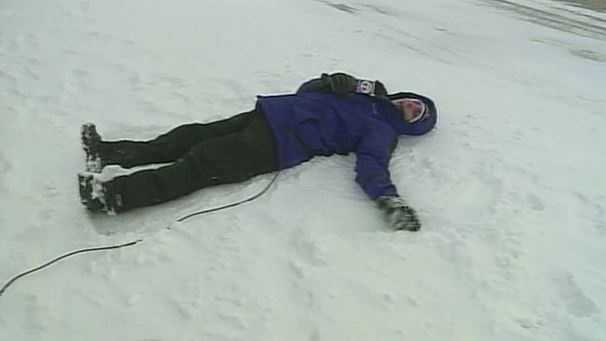 Aaron makes a snow angel on TV.