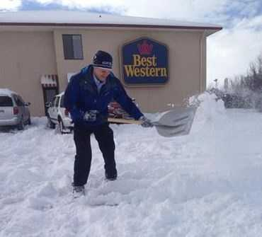 Mike Springer shovels some snow to set up a shot.