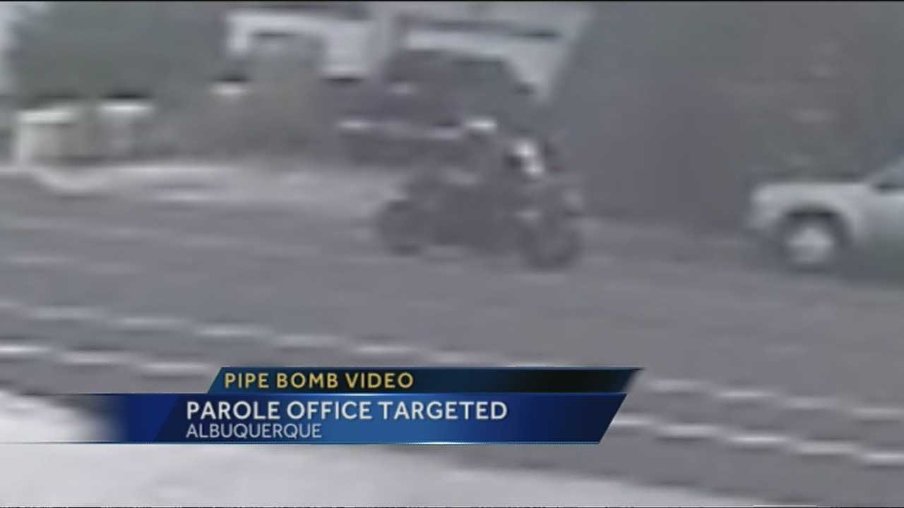 A possible break in the case of two pipe bombs found in front of an Albuquerque probation and parole office was caught on camera.
