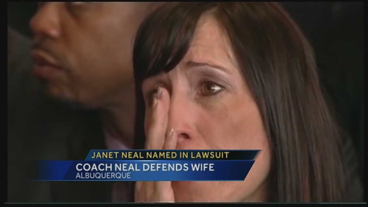 A lawsuit says the wife of New Mexico basketball coach Craig Neal attacked a school administrator and Albuquerque's school superintendent didn't do enough to prevent it.