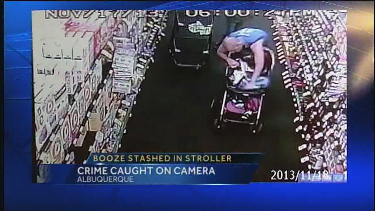 A couple was accused of stealing three bottles of vodka and stashing it in a stroller with their 1-year-old baby. That act was caught on camera.