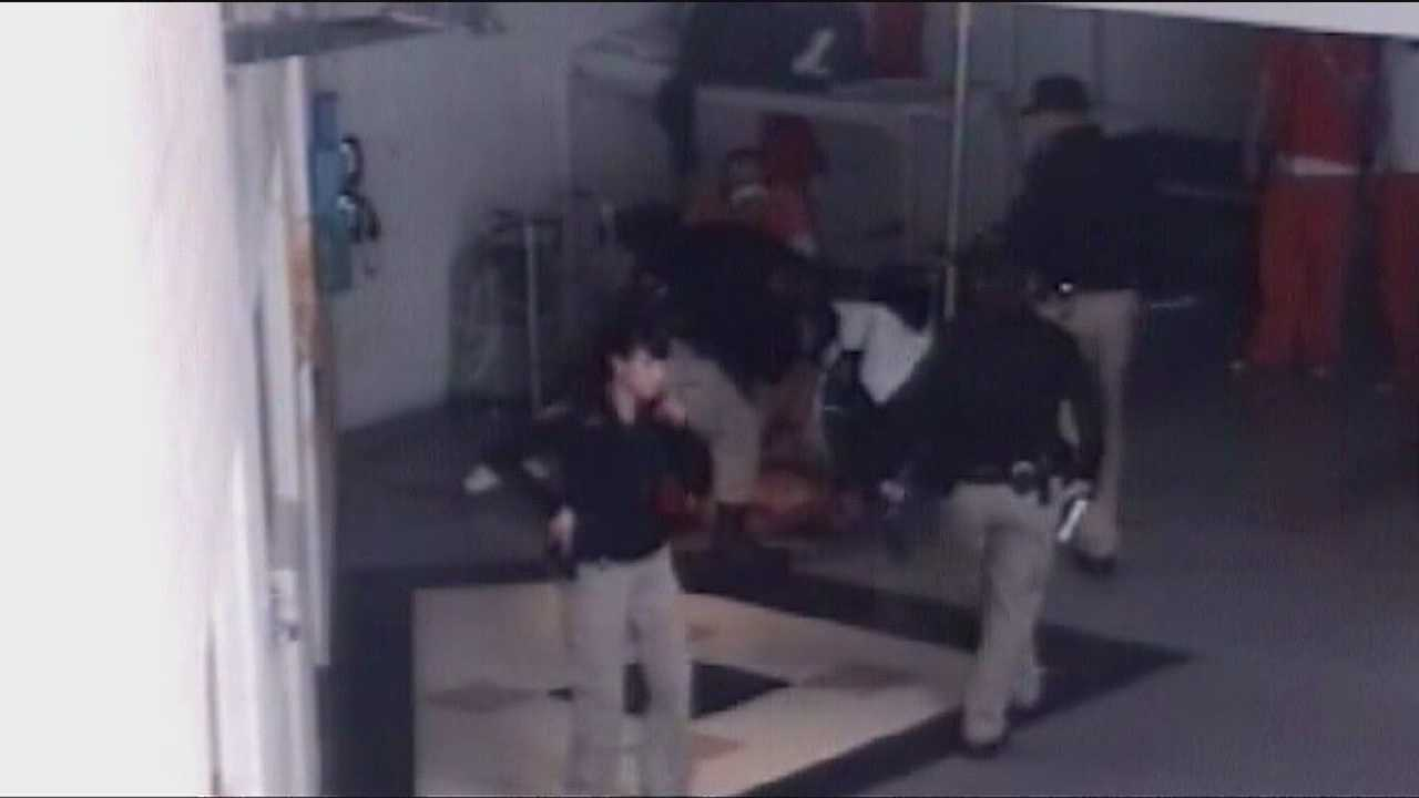 An MDC corrections officer is on paid leave tonight as detectives investigate a fistfight with an inmate and it was caught on camera.
